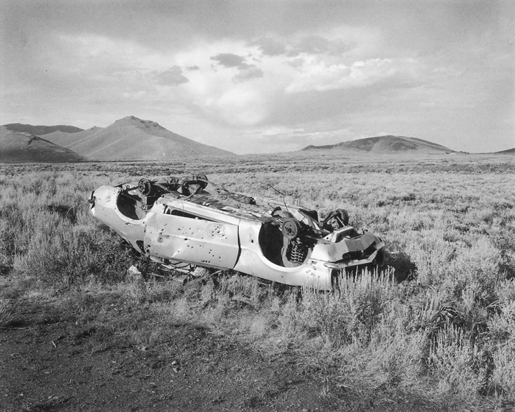 Mark Ruwedel, Bullet-riddled car, Snake River Plain, Idaho. ©Mark Ruwedel