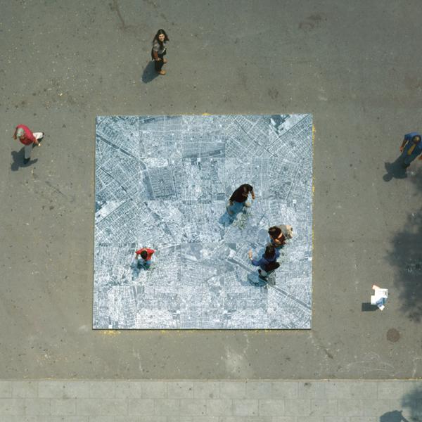 Oscar Muñoz, Ambulatorio, 1994–2003 (installation view), 36 b+w photographs, security glass 600 x 600 cm. © Oscar Muñoz