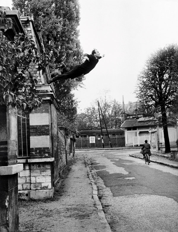 "Yves Klein, Le Saut dans le vide [Leap into the Void], 5, rue Gentil-Bernard, Fontenay-aux-roses, France, October 1960 [the title of this work by Yves Klein, according to his newspaper Dimanche 27 novembre 1960, is, ""A man in space ! The painter of space throws himself into the void!""], Artistic action, © Yves Klein, ADAGP, Paris. Photo © Roy Lichtenstein Foundation, photo Harry Shunk-John Kender, courtesy of Yves Klein Archives"
