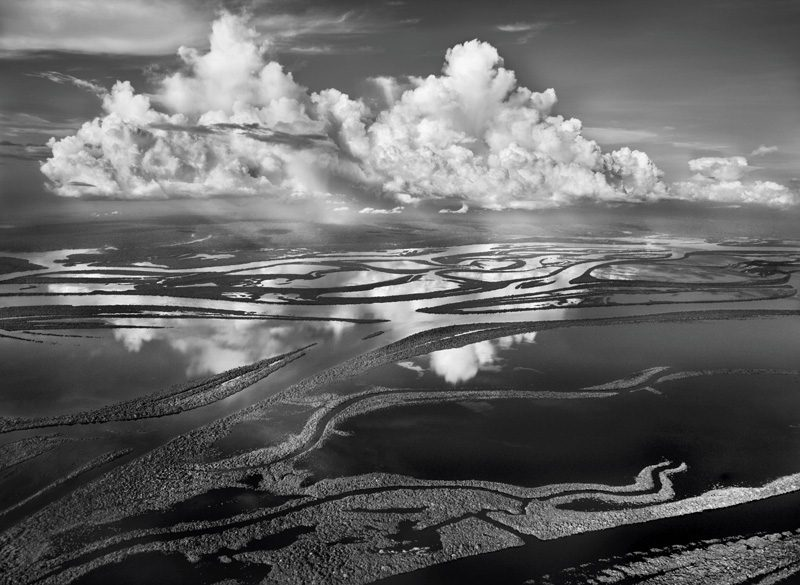 Sebastião Salgado, The Anavilhanas, the name given to around 350 forested islands in Brazil's Rio Negro, form the world's largest inland archipelago. Covering 390 square miles (1,000 square kilometers) of Amazonia, they start 50 miles (80 kilometers) northwest of Manaus and stretch some 250 miles (400 kilometers) up the Rio Negro, as far as Barcelos. Amazonas, Brazil, 2009. © Sebastião Salgado / Amazonas Images