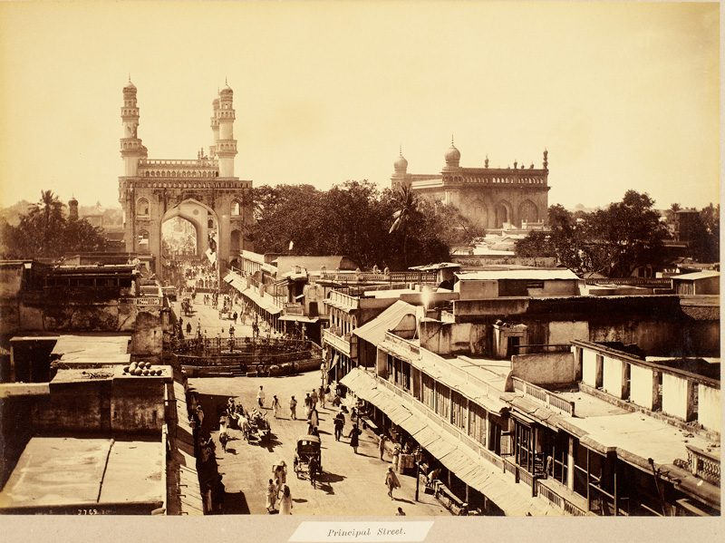 """Raja Deen Dayal, Principal Street leading to Char Minar, December 1887-February 1888, Albumen print, Hyderabad, Andhra Pradesh, India. Royal Ontario Museum, 2007.17.13.55 Cyrus and Ruth Jhabvala Collection, Gift of the Louise Hawley Stone Charitable Trust. Presented by Deepali Dewan, in """"Visions of Colonialism and Modernity: 19th-century India and the Photographs of Deen Dayal """", November 12, 2009"""