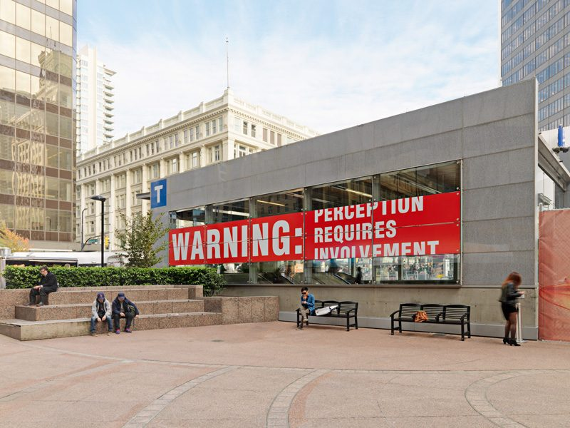Antoni Muntadas, Warning, 1999-2013, installation at the Vancouver City Centre Canada line station, vinyl on glass, photo: Rachel Topham, Vancouver Art Gallery, courtesy of Muntadas / SODRAC