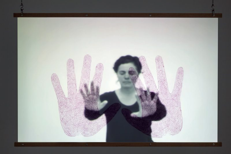 Manon Labrecque, Touchée, 2015, black-and-white hd video installation, drawing on tracing paper