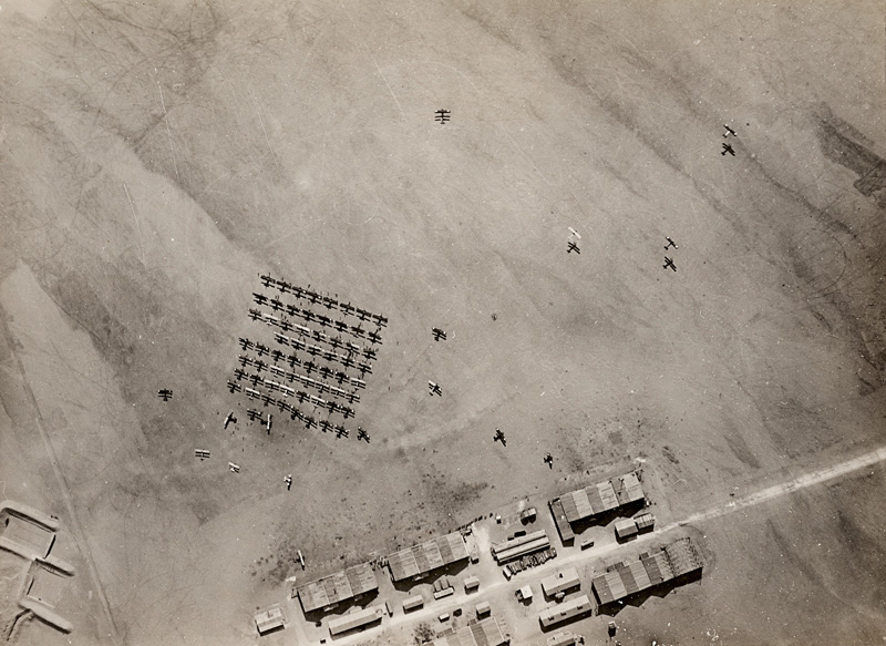 Photographer unknown, Aerial view of British Royal Air Force aircraft taking off in the deserts of Palestine, c. 1917, vintage military aerial view photo from broken glass plate negative, 1916, silver gelatin print, Collection David Campany