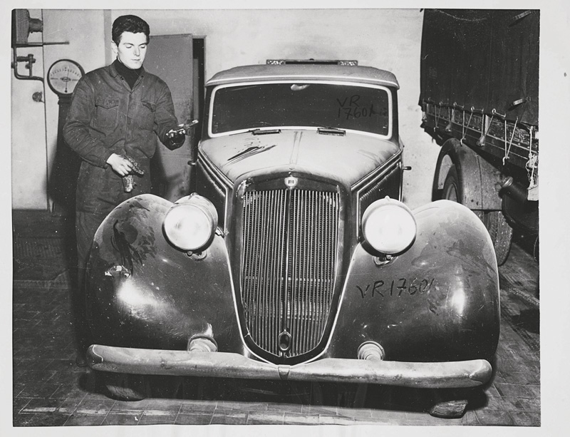 Photographer unknown, Benito Mussolini's dust covered motor car languishes in a Milan garage ten years after his death, 1955, silver print, United Press Agency